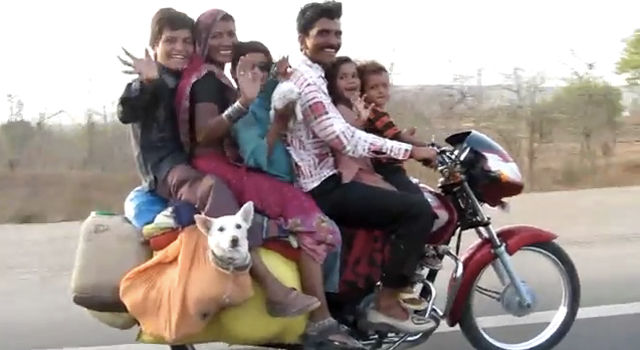 6persons and one dog on motorcycle in India